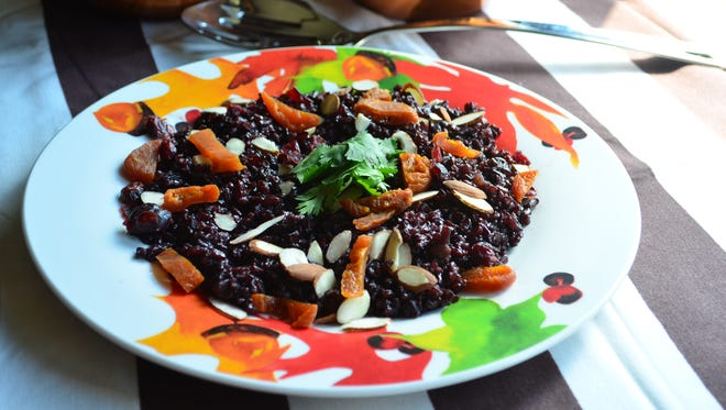 This black rice pilaf makes a wonderful autumn side dish. The rice is nutty and earthy, balanced by sweet dried apricots, raisins and almonds.