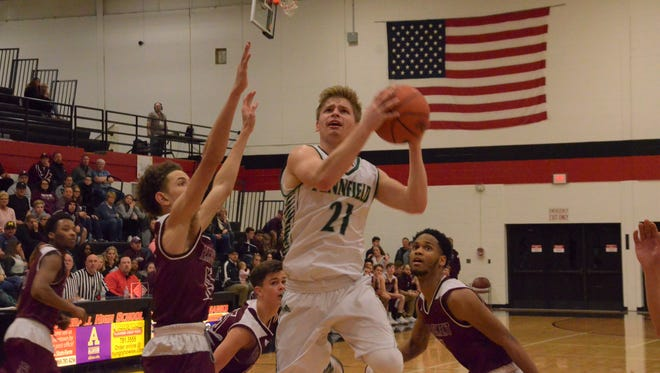 Pennfield's Grant Petersen goes up for a layup against Parchment in a Class B district semifinal at Marshall on March 7, 2018.