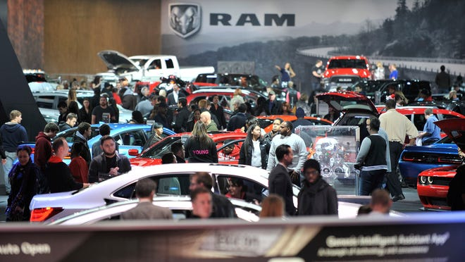 Crowds make their wary through the Chrysler and Ram displays at the North American International Auto Show at Cobo Center in Detroit.