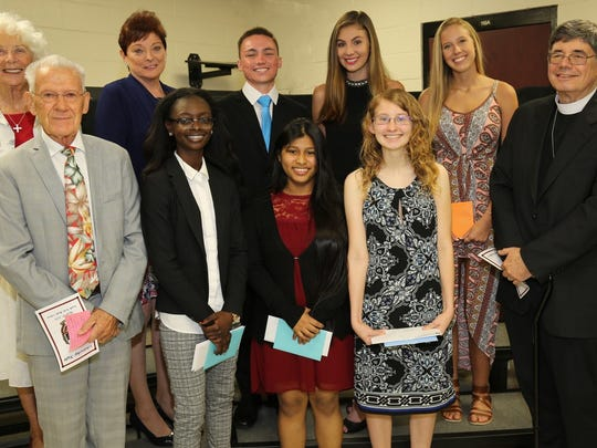 2018 DiFiore Glover Scholarship Recipients, back row, from left, Marilyn Mawhinney and Diane Dougiello, DiFiore-Glover Committee Members; Lee Parisi; Olivia Pratt; Madison Garritty. Front row: DiFiore-Glover Scholarship Fund Founder Buddy Glover, Rai'me Weaver, Sandra Juan, Georgie Arsenault, and the Rev. W. Frisby Hendricks III, Rector, All Saints' Episcopal Church.