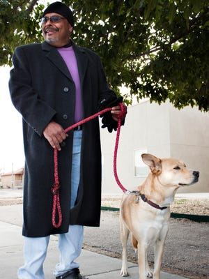Army veteran Sgt. Sam Micelli, who served from 1987-1992, is pictured with his dog Sorri on Monday while attending a news conference discussing New Mexico's commitment to functionally end veteran homelessness. Las Cruces was the first city in New Mexico and the 13th in the country to be formally recognized.
