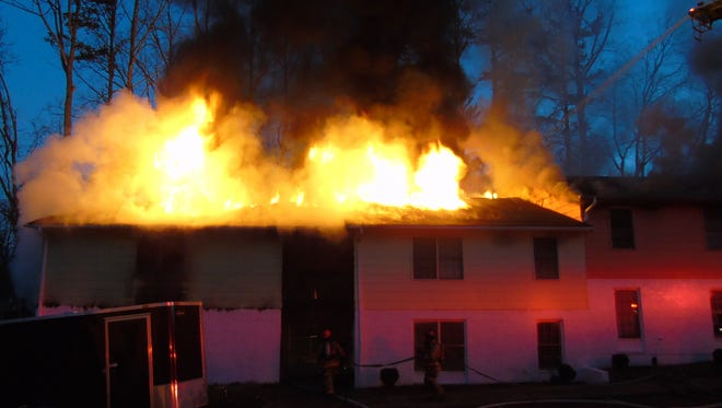 Fire destroyed an apartment building at Solutions Recovery Center Friday.