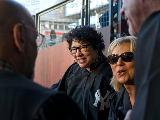 U.S. Supreme Court Justice Sonia Sotomayor, center, stands with family and friends just before the Boston Red Sox played the New York Yankees during a baseball game Thursday, Aug. 31, 2017, in New York. (AP Photo/Craig Ruttle)