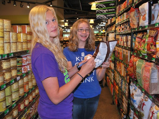 Real Food camp participants seek out Iowa-produced products at Gateway Market in Des Moines to better understand local food systems.