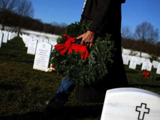 Holiday Wreaths Are Placed At Arlington National Cemetery