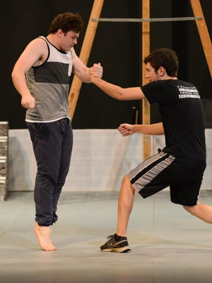 """Jesse Crook, left, playing Riffle and Nick Squires, right, playing Bernard rehearse a knife fight during rehearsal for """"West Side Story"""" July 6 at Ohio University Lancaster."""