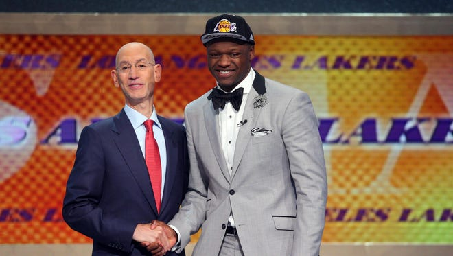 Julius Randle (Kentucky) shakes hands with NBA commissioner Adam Silver after being selected as the number seven overall pick to the Los Angeles Lakers in the 2014 NBA Draft at the Barclays Center.