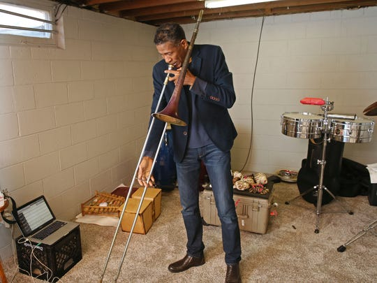 World-renowned composer and musician William Cepeda practices trombone for a benefit concert.