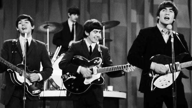 "FILE - In this Feb. 9, 1964 file photo, The Beatles, from left, Paul McCartney, Ringo Starr on drums, George Harrison and John Lennon, perform for the CBS ""Ed Sullivan Show"" in New York, as they record a set that would later be shown on the Feb. 23 broadcast of the show. The Beatles made their first broadcast appearance on ""The Ed Sullivan Show,"" America's must-see weekly variety show, later in the day, Sunday, Feb. 9, 1964, officially kicking off Beatlemania. (AP Photo/Dan Grossi, File) ORG XMIT: NYET211"