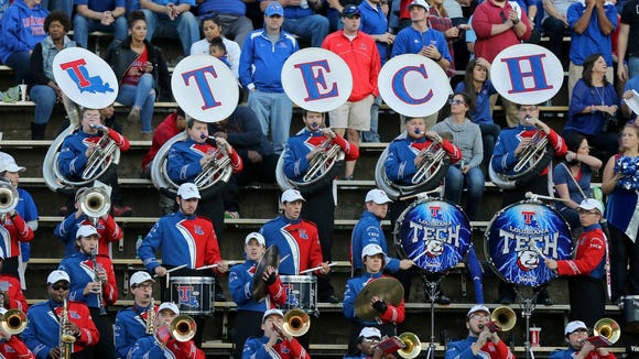 The Louisiana Tech Bulldogs band performs in the stands in the second quarter of their game against the Southern Miss Golden Eagles at M.M. Roberts Stadium. Mandatory Credit: Chuck Cook-USA TODAY Sports