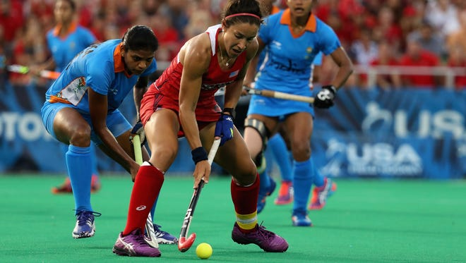 Melissa Gonzalez #5 of Team USA passes the ball against Team India in the second half during a field hockey match in preparation for the upcoming Rio Olympics on July 18, 2016 in  Manheim, Pennsylvania.