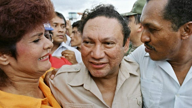 Former Panamian military strong man General Manuel Antonio Noriega is pictured with supporters.