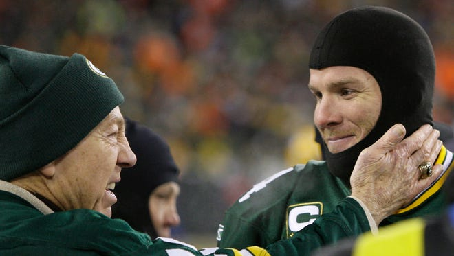 Green Bay Packers quarterback Brett Favre, right, talks with former Packers quarterback Bart Starr, left, before the NFC championship game against the New York Giants at Lambeau Field on Jan. 20, 2008.