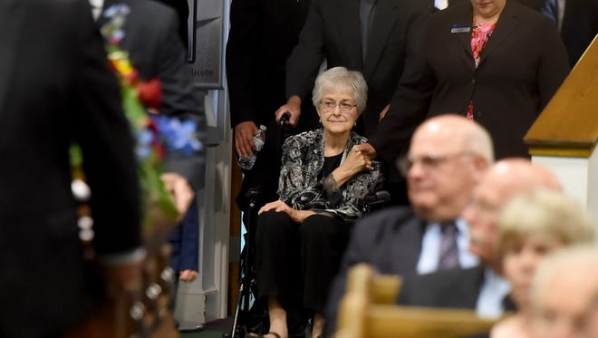 Nona Brown, pictured here being wheeled by family and friends at her husband Stan's funeral in August, passed away Saturday at York Hospital.