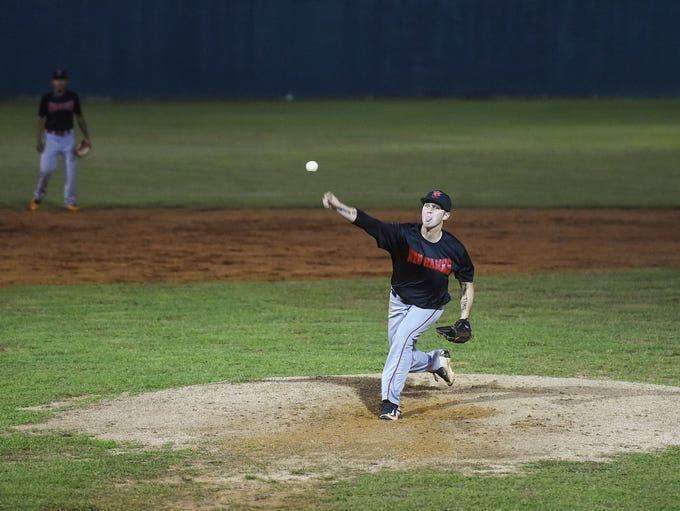 Yona RedHawks player Ryan Coleman pitches against the
