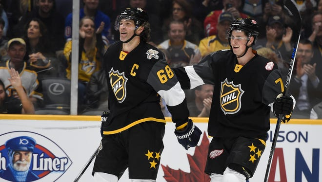 Panthers forward Jaromir Jagr (68) is congratulated by Red Wings forward Dylan Larkin (71) after scoring during the NHL All-Star Game at Bridgestone Arena.