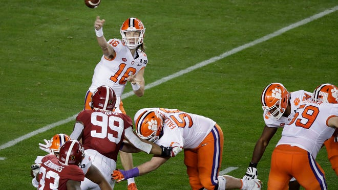 Clemson's Trevor Lawrence throws during the first half of the NCAA college football playoff championship game against Alabama, Monday, Jan. 7, 2019, in Santa Clara, Calif. (AP Photo/Jeff Chiu)