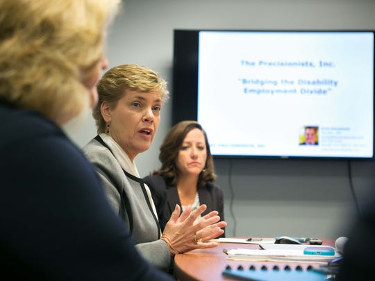 Kendal Reynolds (from left), Diane Shea and Patricia Pfarrer with The Precisionists, talks about the aim of the company to hire, train and find employment for people with autism and other disabilities in the IT field.