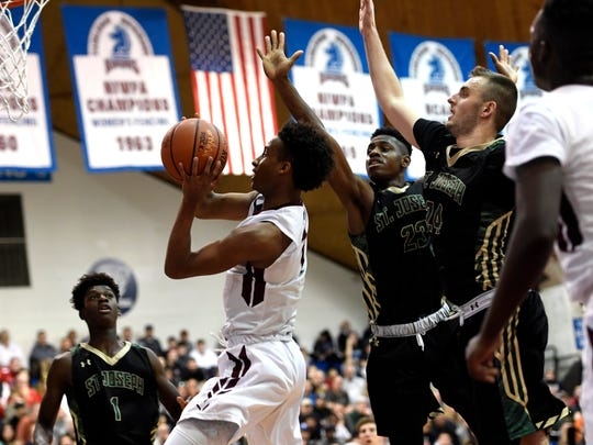 Don Bosco's Chris Paul drives to the net past St. Joseph's defenders in the second half on Sunday