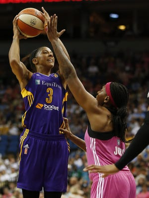 Los Angeles Sparks center Candace Parker (3) shoots against Minnesota Lynx forward Asjha Jones during the first half of a WNBA game on Aug. 9, 2015, in Minneapolis.