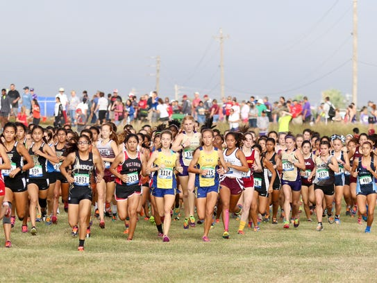 The start of the girls Class 5A race at the Region