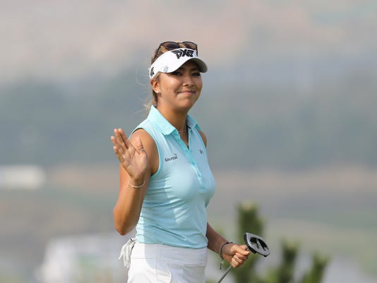 Alison Lee of the United States waves after sinking a birdie putt on the 6th hole during the third round of the LPGA KEB Hana Bank Championship at Sky72 Golf Club in Incheon, South Korea, Saturday, Oct. 15, 2016. (AP Photo/Lee Jin-man)