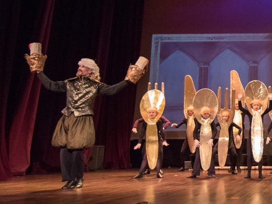 "Lumiere (Brian Schneider) and members of the ensemble at a dress rehearsal of ""Beauty and the Beast."""