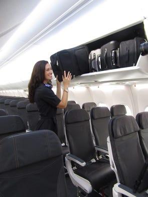 Alaska Airlines flight attendant Jenn-Marie Mann shows