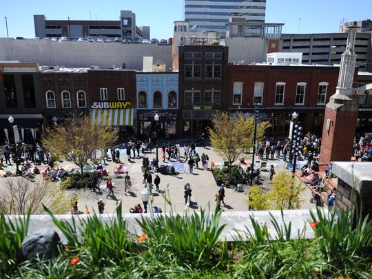 Crowds gather in Market Square to observe the eighth annual Dogwood Arts Chalk Walk on April 9, 2016.