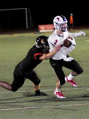 Cameron Naber (2) of Oak Hills takes a completed pass