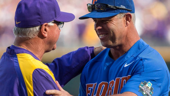 Jun 26, 2017; Omaha, NE, USA; Florida Gators head coach Kevin O'Sullivan and LSU Tigers head coach Paul Mainieri greet other at home plate prior to game one of the championship series of the 2017 College World Series at TD Ameritrade Park Omaha. Mandatory Credit: Bruce Thorson-USA TODAY Sports