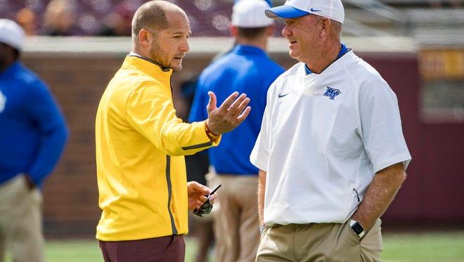 Minnesota coach P.J. Fleck and MTSU coach Rick Stockstill talk during pregame warmups Sept. 16, 2017, at TCF Bank Stadium.