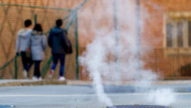 Steam rises from a man hole on the UT campus in Knoxville on Jan. 2, 2018. The recent cold weather prompted the Knox County Democratic Party to open its offices as a temporary shelter.