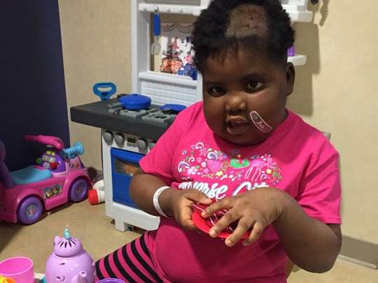 Chika plays after an experimental procedure at Sloan Kettering Hospital in New York called CED, Convection Enhanced Delivery in October 2015.