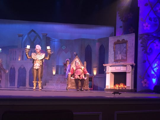 Lumiere (Andrew Jarema) meets Belle's father, Maurice