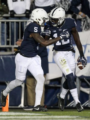 Penn State Nittany Lions wide receiver Chris Godwin (12) is congratulated by wide receiver DaeSean Hamilton (5) after scoring a touchdown during the third quarter against the Michigan State Spartans at Beaver Stadium. Penn State defeated Michigan State 45-12.