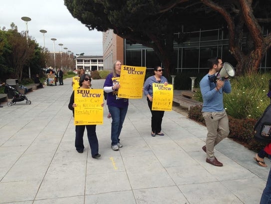 Caregivers picket Tuesday outside the Monterey County