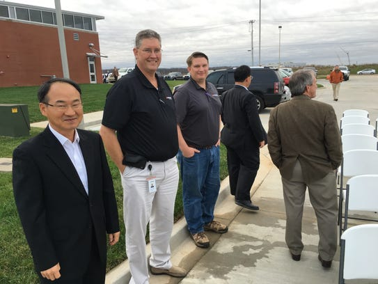 Hankook executives, from left, attending the ribbon-cutting
