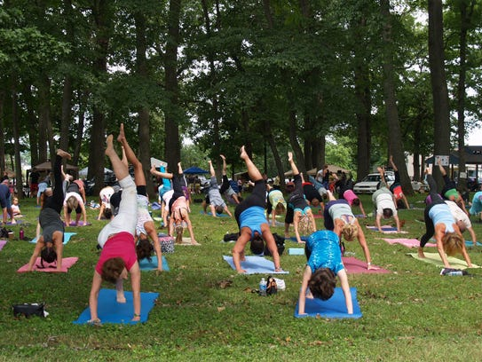 Mingle with fellow yoga lovers during Yogis Take the