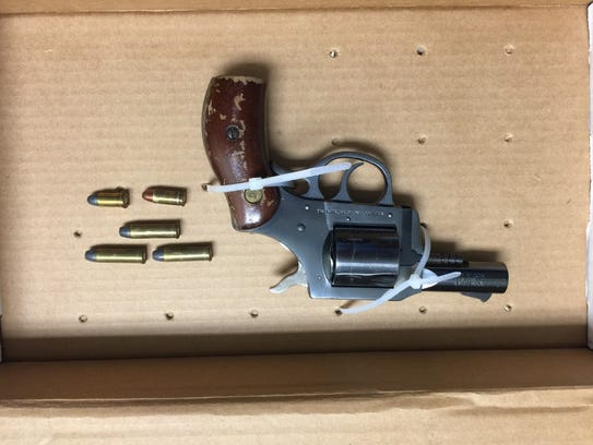 A revolver police say they recovered from a Kia driven