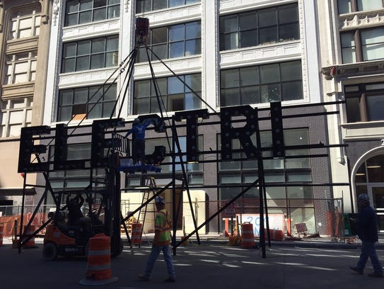 """The """"ElectriCity"""" sign is installed on the Martin Lofts."""