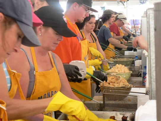 Ten people manned the cheese curd friers full time