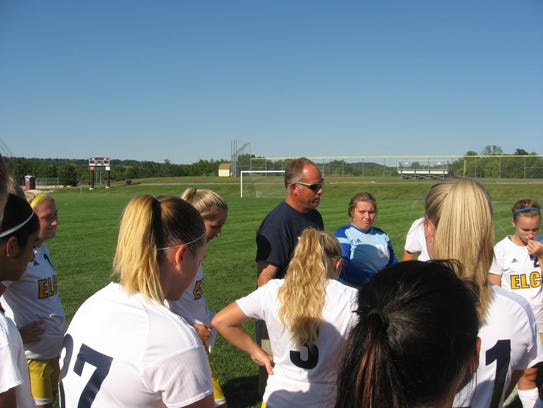 Elco coach Derek Fulk talks to his team prior to overtime