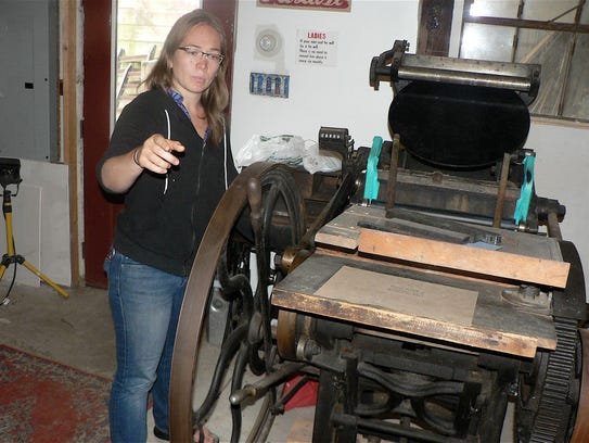 Cari Stebbins and one of her old, but working, letterpresses.