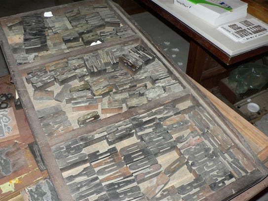 Tables and drawers full of lead slugs used in the printing