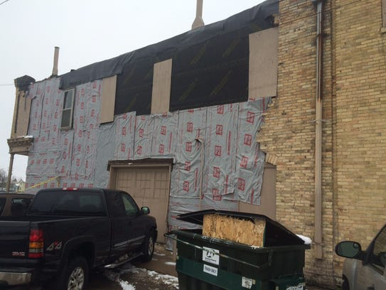 A patched south-facing wall of 716 S. Main St., Oshkosh.