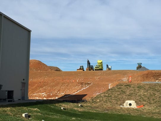 Construction sits atop a hill behind Godshall's Quality