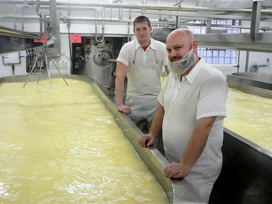Josh Johnson (left) and Mike Nelson proudly make cheese