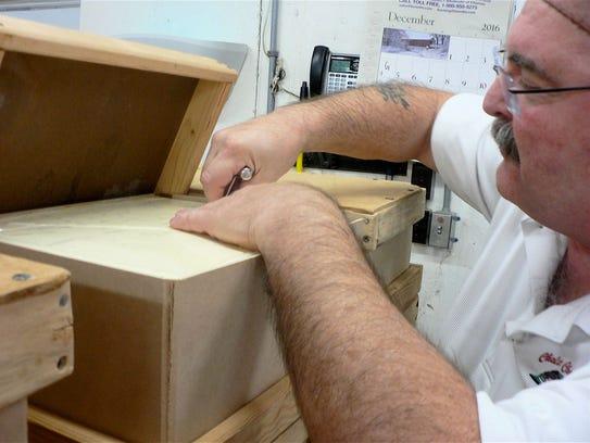 Myron Olson samples a 40-pound block of Baby Swiss.