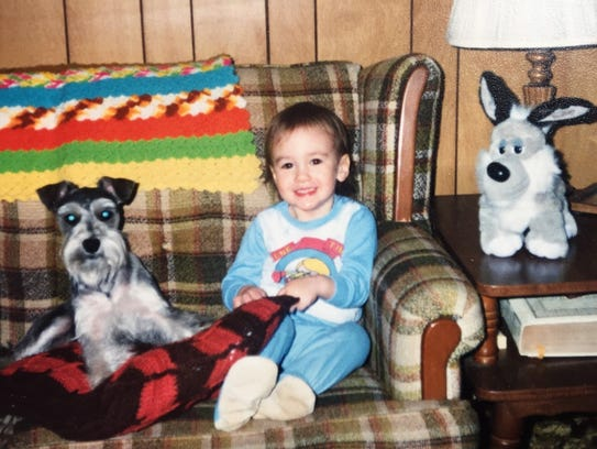 Jared Lewis, at age 2, loved the family dog, Lacy.